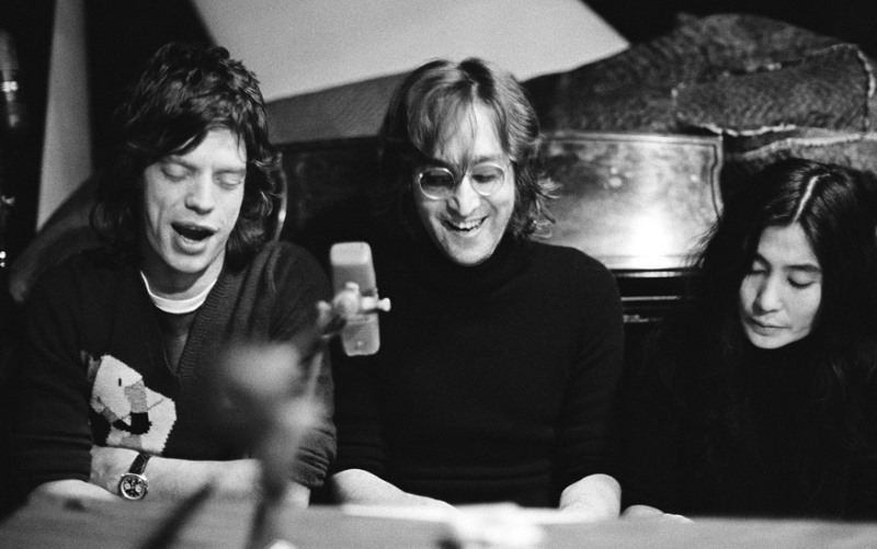 (L-R) Mick Jagger of The Rolling Stones, John Lennon and Yoko Ono singing at a piano at The Record Plant, NYC. 1972. © Bob Gruen / www.bobgruen.com Please contact Bob Gruen's studio to purchase a print or license this photo. email: websitemail01@aol.com phone: 212-691-0391